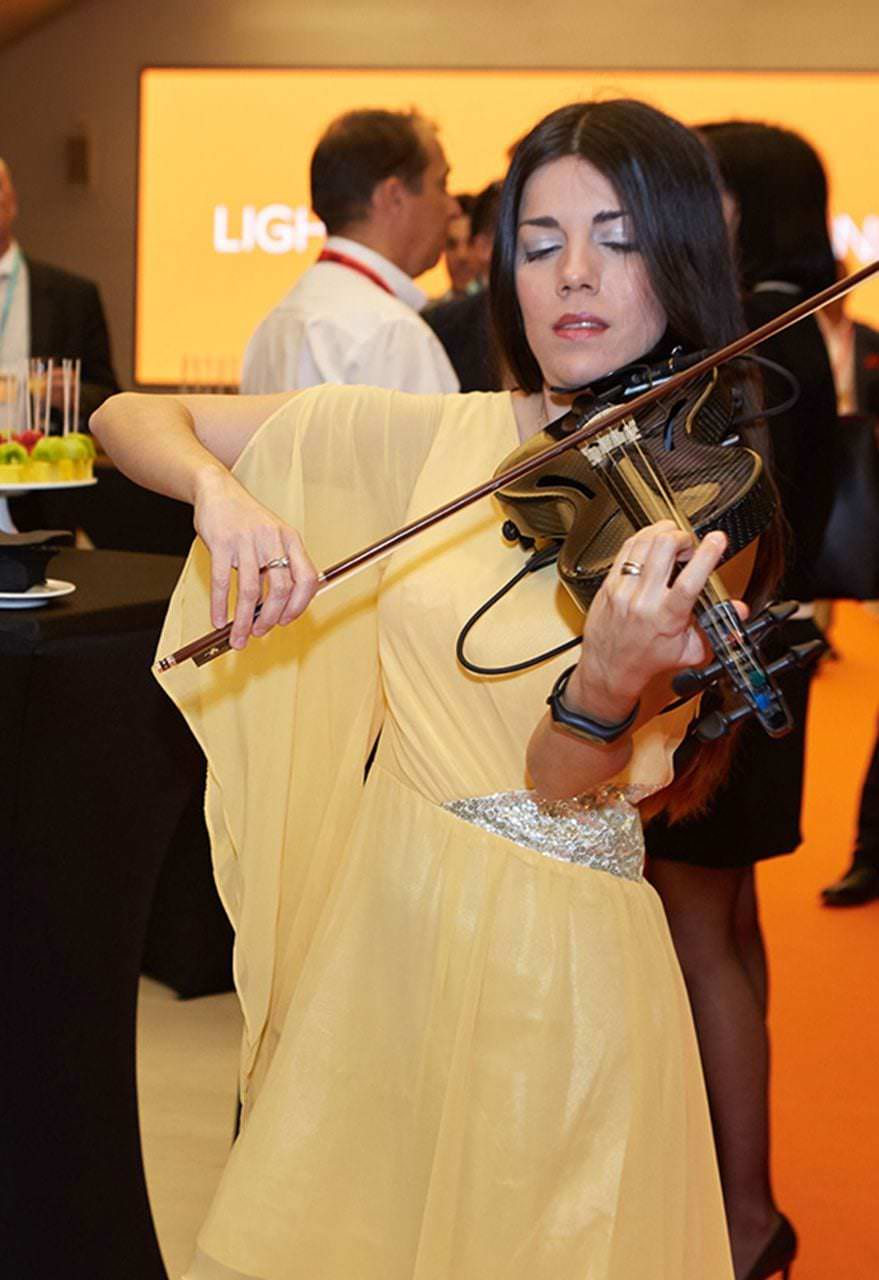 Violinist at the Solpheo Suite Presentation event